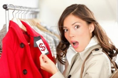 11155123-shopping-woman-shocked-and-surprised-over-price-looking-at-price-tag-on-coat-or-jacket-woman-shopper